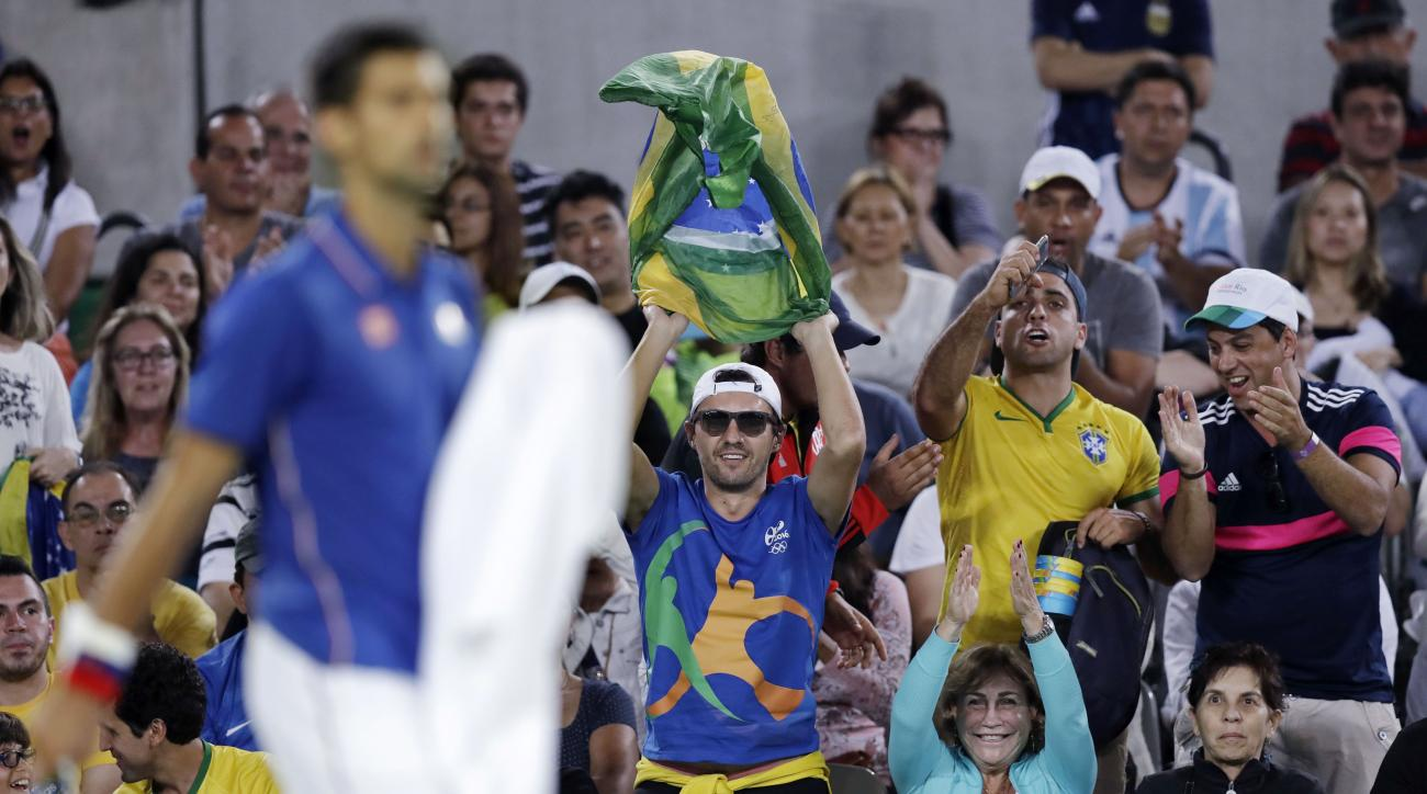 Fans cheer for Novak Djokovic, of Serbia, during his match against Juan Martin del Potro, of Argentina, at the 2016 Summer Olympics in Rio de Janeiro, Brazil, Sunday, Aug. 7, 2016. (AP Photo/Charles Krupa)