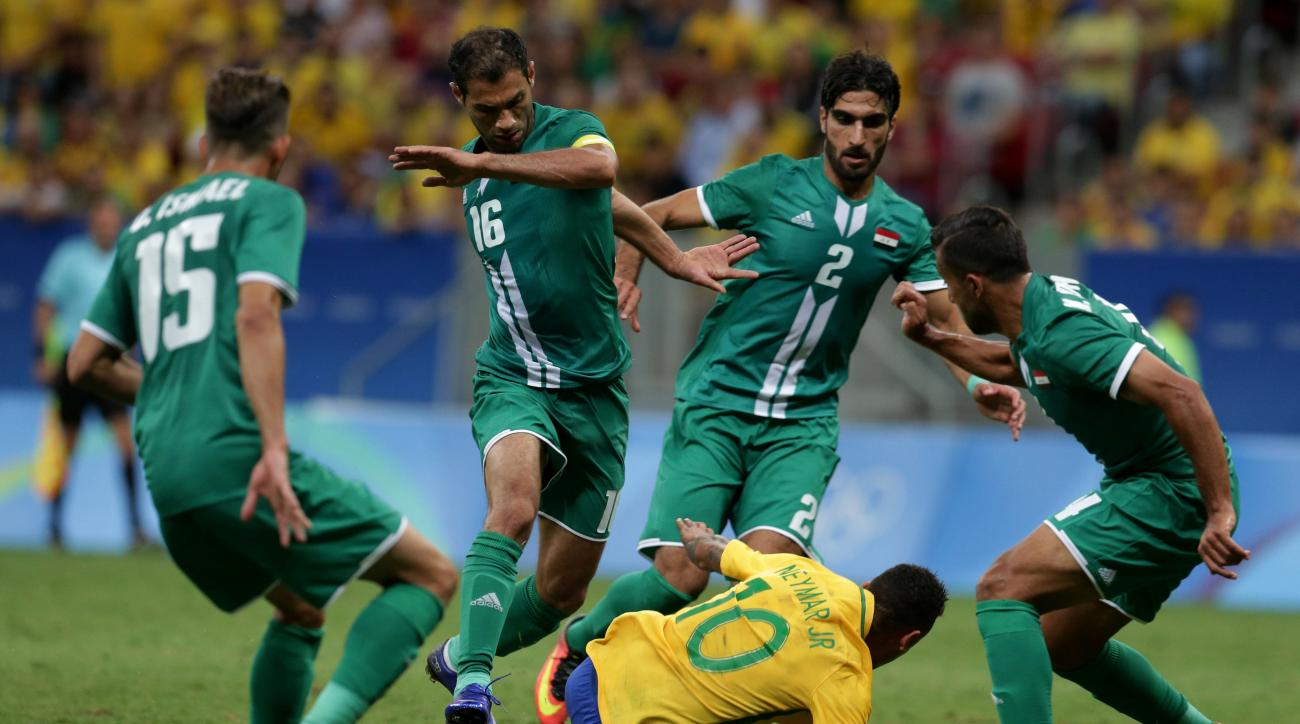 Brazil's Neymar, bottom, falls to the field surrounded by Iraq players during a group A match of the men's Olympic football tournament between Brazil and Iraq at the National Stadium in Brasilia, Brazil, Sunday, Aug. 7, 2016. (AP Photo/Eraldo Peres)