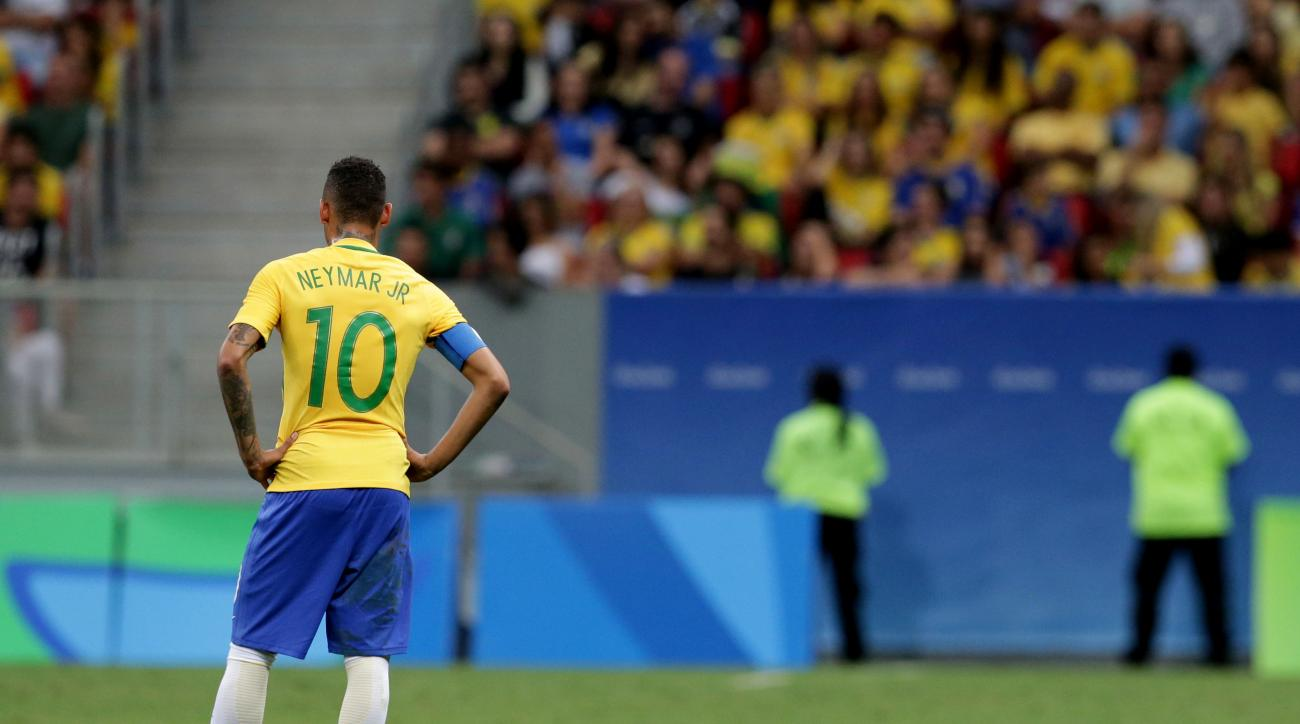 Brazil's Neymar stands on the field at the end of a group A match of the men's Olympic football tournament between Brazil and Iraq at the National Stadium in Brasilia, Brazil, Sunday, Aug. 7, 2016. The game ended in a 0-0 draw. (AP Photo/Eraldo Peres)