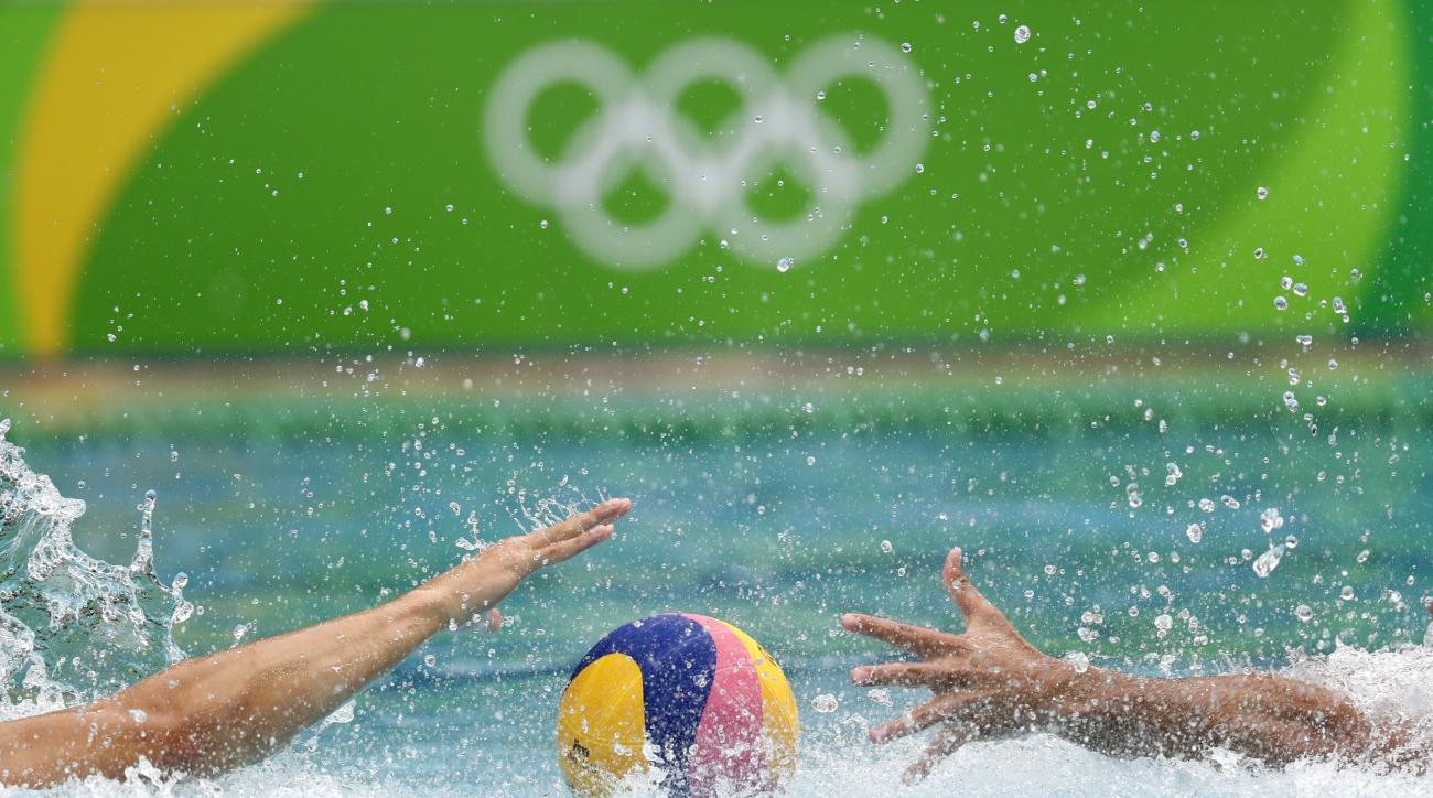 Serbia's Stefan Mitrovic, left, and Greece's Evangelos Ioannis Delakas fight for the ball during their men's water polo preliminary round match at the 2016 Summer Olympics in Rio de Janeiro, Brazil, Monday, Aug. 8, 2016. (AP Photo/Sergei Grits)