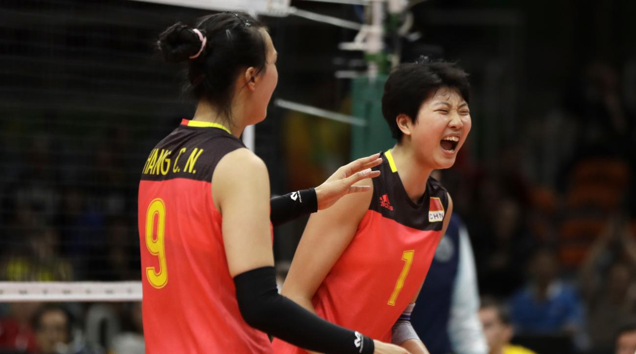 China's Zhang Changning (9) and Yuan Xinyue (1) celebrate during a Women's preliminary volleyball match against Italy at the 2016 Summer Olympics in Rio de Janeiro, Brazil, Monday, Aug. 8, 2016. (AP Photo/Matt Rourke)