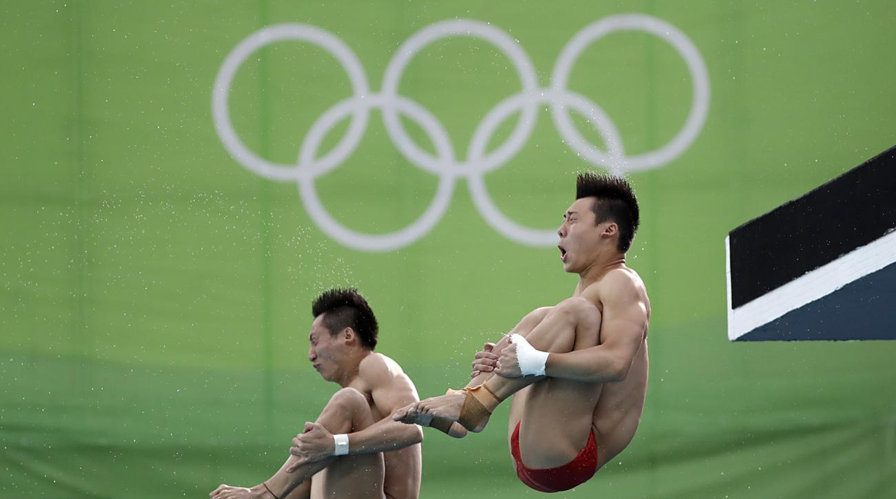 China's Lin Yue, left, and Chen Aisen, right, take part in a training session ahead of the men's synchronized 10-meter platform diving final in the Maria Lenk Aquatic Center at the 2016 Summer Olympics in Rio de Janeiro, Brazil, Monday, Aug. 8, 2016. (AP