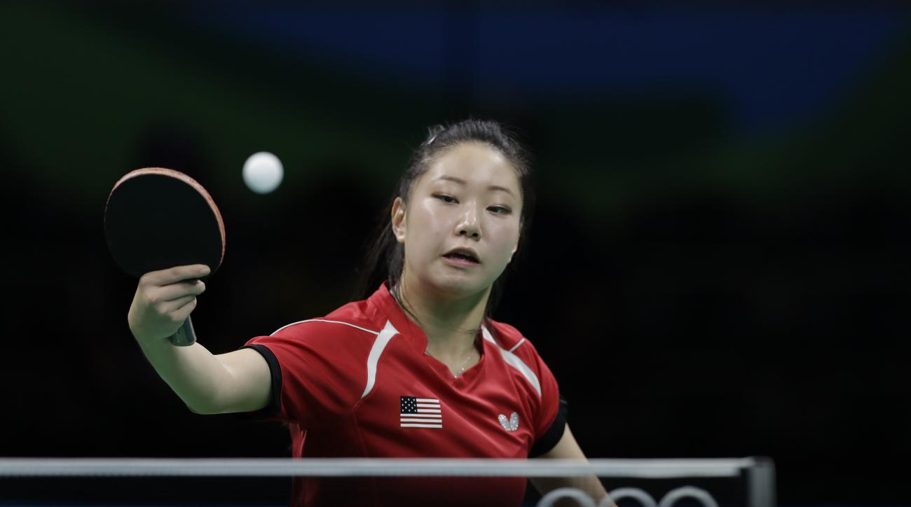 Lily Zhang of United States plays against Suh Hyo-Won of South Korea during their table tennis match at the 2016 Summer Olympics in Rio de Janeiro, Brazil, Monday, Aug. 8, 2016.(AP Photo/Petros Giannakouris)