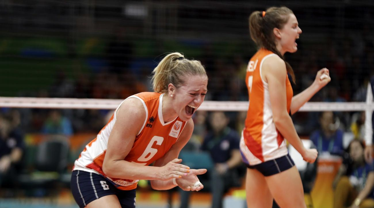 Netherlands' Maret Balkestein-Grothues (6) and Yvon Belien right, celebrate during a Women's preliminary volleyball match against the United States at the 2016 Summer Olympics in Rio de Janeiro, Brazil, Monday, Aug. 8, 2016. (AP Photo/Matt Rourke)