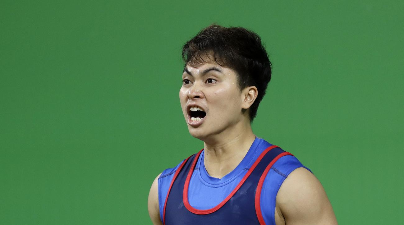 Pimsiri Sirikaew, of Thailand, walks to the barbell to attempt a lift in the women's 58kg weightlifting competition at the 2016 Summer Olympics in Rio de Janeiro, Brazil, Monday, Aug. 8, 2016. (AP Photo/Mike Groll)