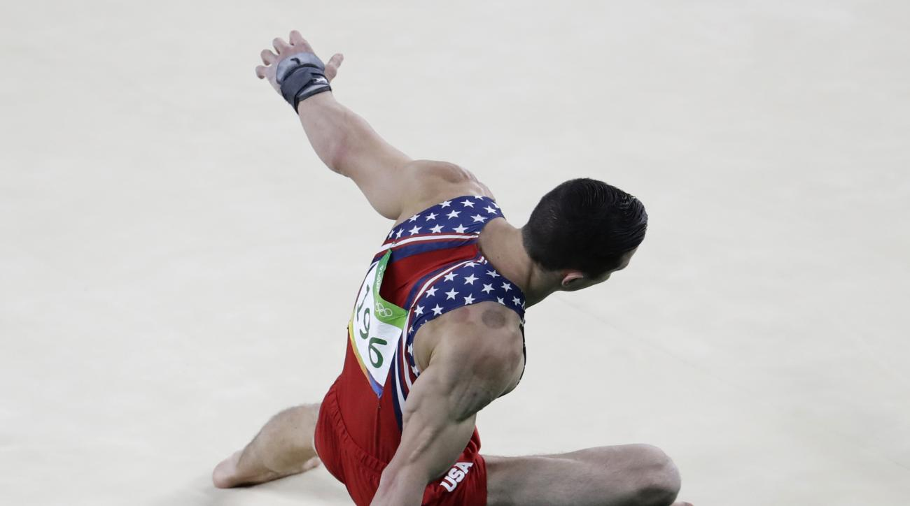 United States' Alexander Naddour performs on the floor during the artistic gymnastics men's team final at the 2016 Summer Olympics in Rio de Janeiro, Brazil, Monday, Aug. 8, 2016. (AP Photo/Dmitri Lovetsky)