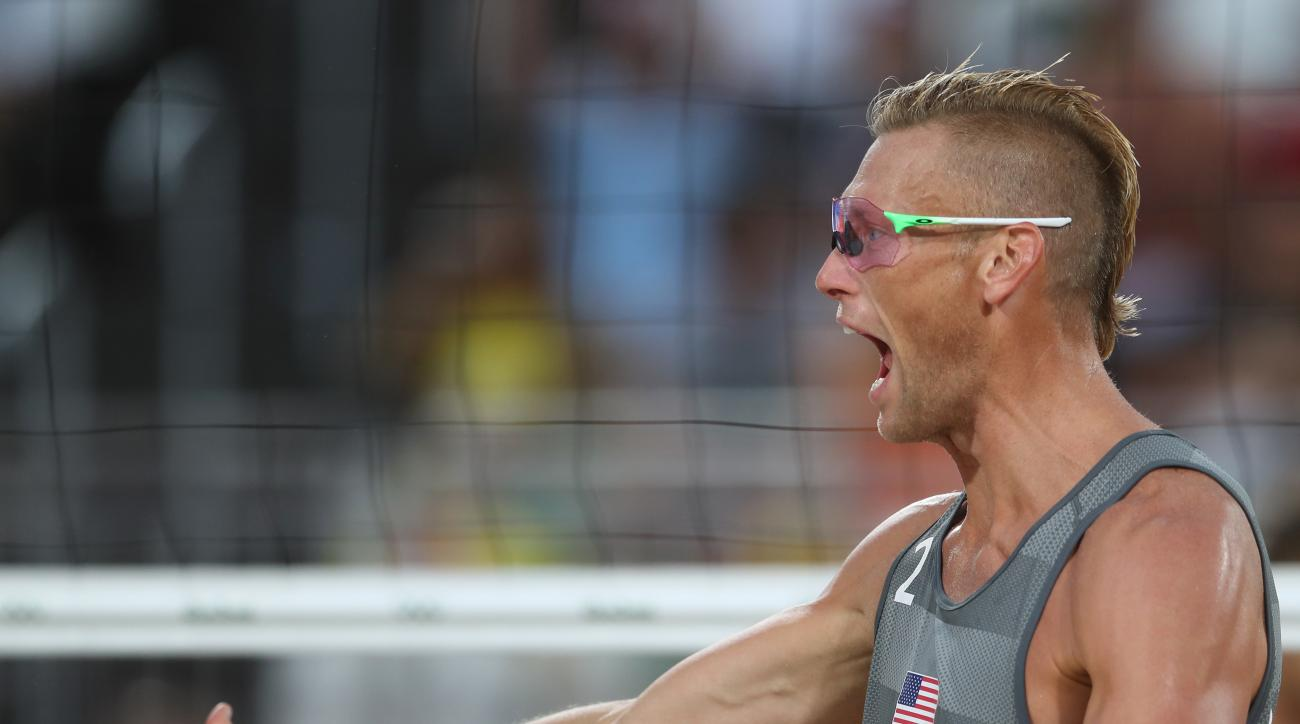 United States' Casey Patterson celebrates winning a point during a men's beach volleyball match against Austria at the 2016 Summer Olympics in Rio de Janeiro, Brazil, Monday, Aug. 8, 2016. (AP Photo/Petr David Josek)
