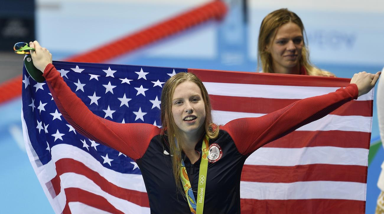 United States' gold medal winner Lilly King celebrates with her country's flag after the women's 100-meter breaststroke final during the swimming competitions at the 2016 Summer Olympics, Tuesday, Aug. 9, 2016, in Rio de Janeiro, Brazil. (AP Photo/Martin