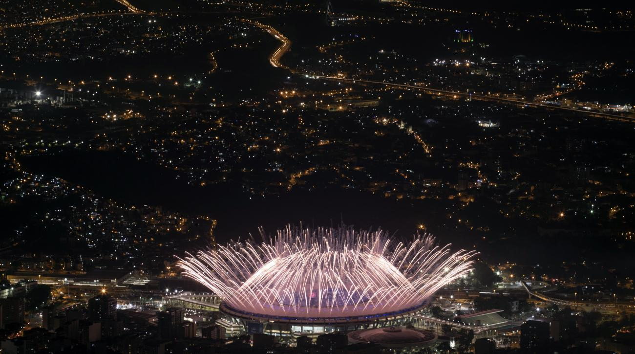 In this Aug. 5, 2016 photo, fireworks explode over Maracana Stadium during the opening ceremony at the 2016 Summer Olympics in Rio de Janeiro, Brazil. Hillary Clinton has the airwaves all to herself during the Rio Olympics. Her Democratic presidential cam