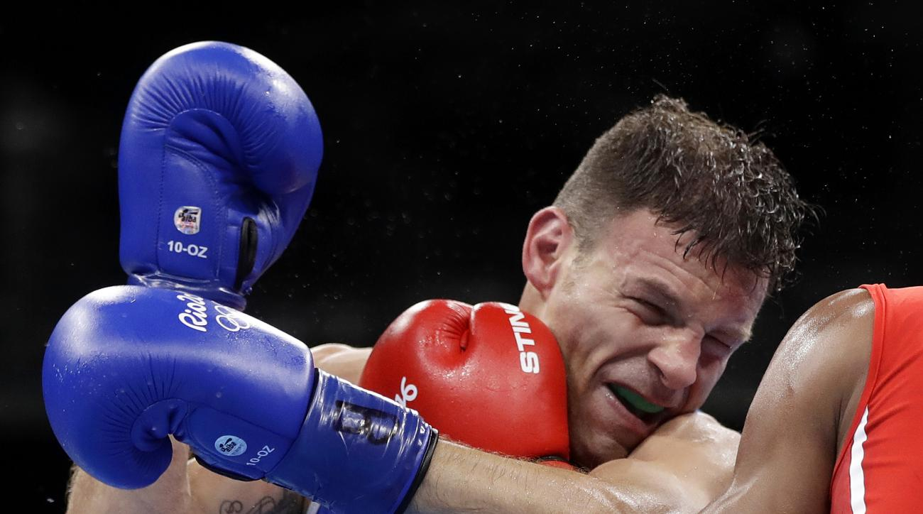 Italy's Carmine Tommasone fights Cuba's Lazaro Alvarez during a men's lightweight 60-kg preliminary boxing match at the 2016 Summer Olympics in Rio de Janeiro, Brazil, Tuesday, Aug. 9, 2016. (AP Photo/Frank Franklin II)
