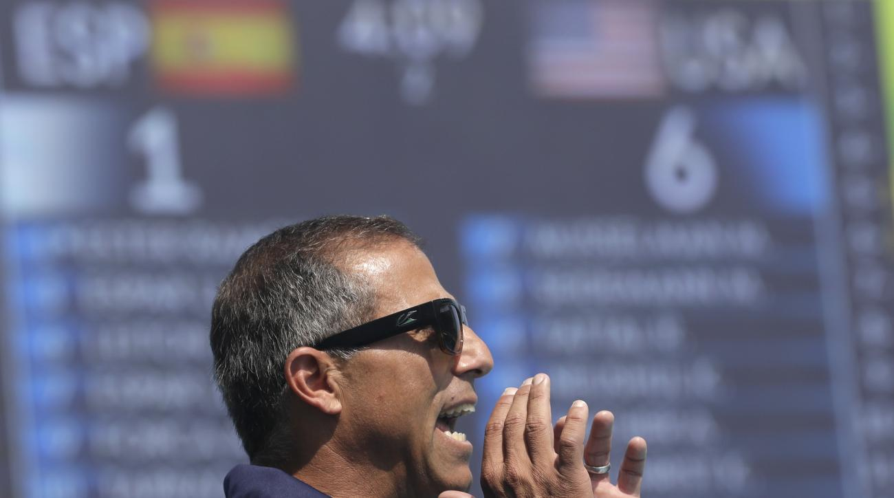 United States' Adam Krikorian reacts as he watches his team play against Spain during their women's water polo preliminary round match at the 2016 Summer Olympics in Rio de Janeiro, Brazil, Tuesday, Aug. 9, 2016. (AP Photo/Sergei Grits)