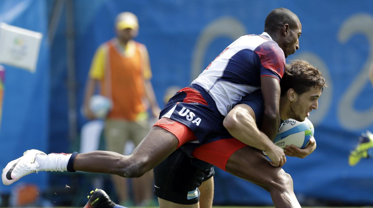 Argentina's Bautista Ezcurra, front, is tackled by United State's Perry Baker, during the men's rugby sevens match at the Summer Olympics in Rio de Janeiro, Brazil, Tuesday, Aug. 9, 2016. (AP Photo/Themba Hadebe)