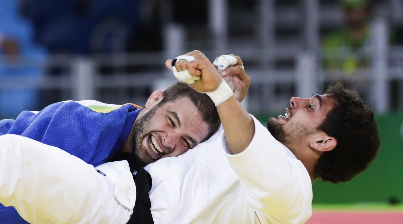 United States' Travis Stevens, blue, celebrates against Bulgaria's Ivaylo Ivanov during the men's 81-kg judo competition at at the 2016 Summer Olympics in Rio de Janeiro, Brazil, Tuesday, Aug. 9, 2016. (AP Photo/Markus Schreiber)