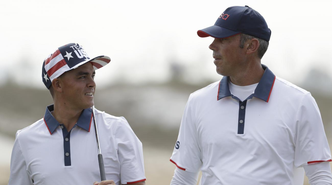 Rickie Fowler, of the United States, left talks to Matt Kuchar, of the, United States, as they walk off the second green during a practice round for the men's golf event at the 2016 Summer Olympics in Rio de Janeiro, Brazil, Tuesday, Aug. 9, 2016. (AP Pho
