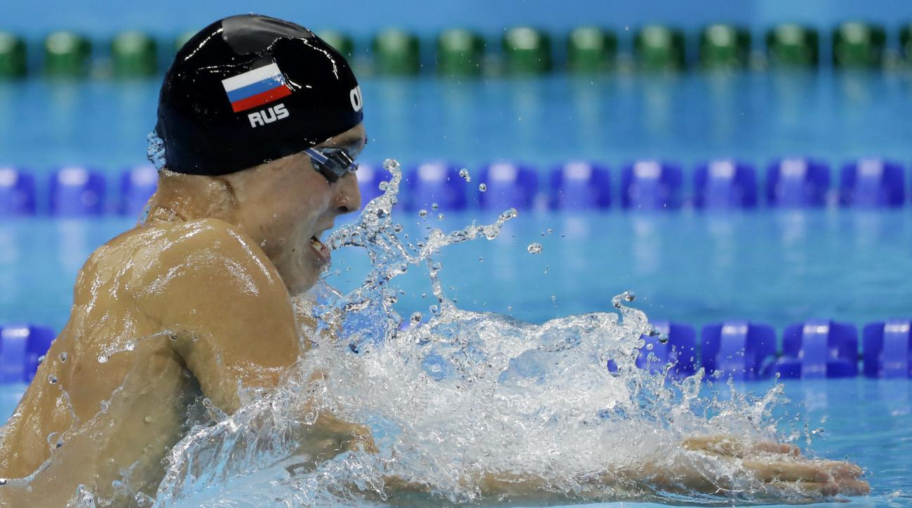 Russia's Anton Chupkov competes in a heat of the men's 200-meter breaststroke during the swimming competitions at the 2016 Summer Olympics, Tuesday, Aug. 9, 2016, in Rio de Janeiro, Brazil. (AP Photo/Matt Slocum)