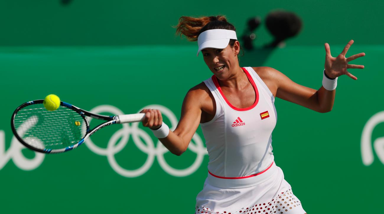 Spain's Garbine Muguruza returns to Puerto Rico's Monica Puig in the women's tennis competition at the 2016 Summer Olympics in Rio de Janeiro, Brazil, Tuesday, Aug. 9, 2016. (AP Photo/Vadim Ghirda)