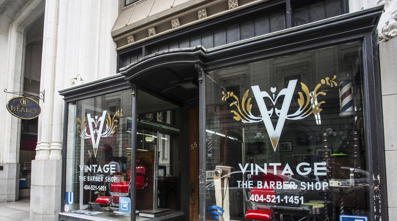 This photo shows the exterior of Vintage the Barber Shop on Tuesday, Aug. 9, 2016, in Atlanta. Swimmer Michael Phelps, of the United States, stopped by the shop before departing for the 2016 Summer Olympics in Rio de Janeiro, Brazil, and posted a selfie o
