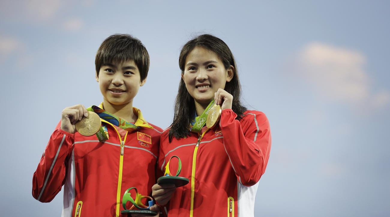 China's gold medalists Liu Huixia, left, and Chen Ruolin, right, pose with their medal after the women's synchronized 10-meter platform diving final in the Maria Lenk Aquatic Center at the 2016 Summer Olympics in Rio de Janeiro, Brazil, Tuesday, Aug. 9, 2