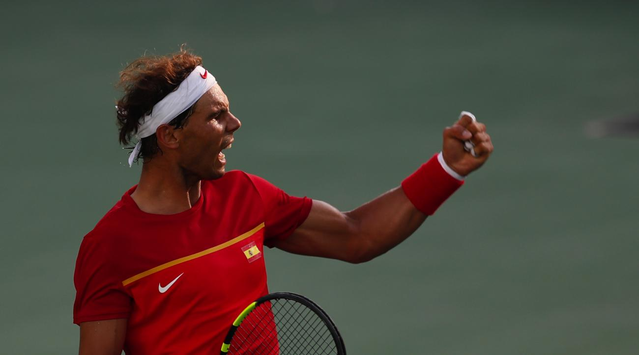 Spain's Rafael Nadal celebrates winning a point during the match against Italy's Andreas Seppi in the men's tennis competition at the 2016 Summer Olympics in Rio de Janeiro, Brazil, Tuesday, Aug. 9, 2016. (AP Photo/Vadim Ghirda)