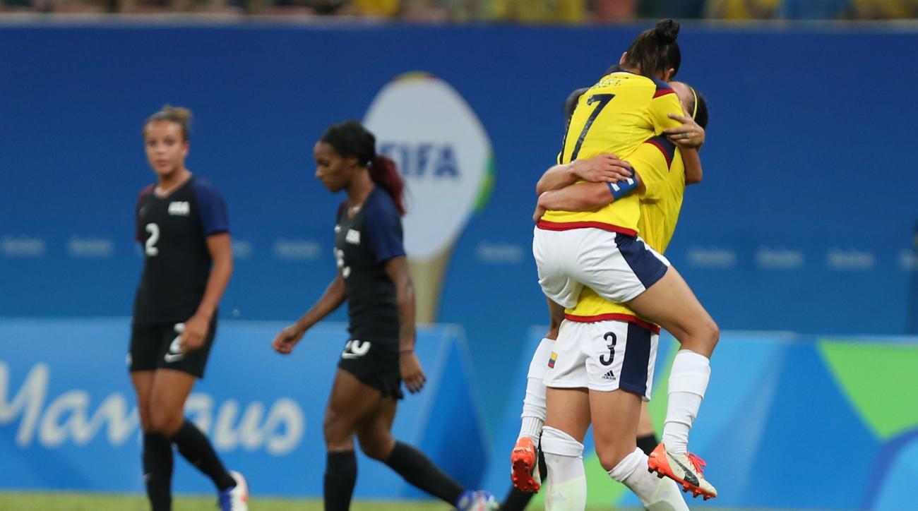Players of Colombia celebrate at the end of a group G match of the women's Olympic football tournament between Colombia and United States at the Arena Amazonia stadium in Manaus, Brazil, Tuesday, Aug. 9, 2016. The game ended in a 2-2 draw. (AP Photo/Micha