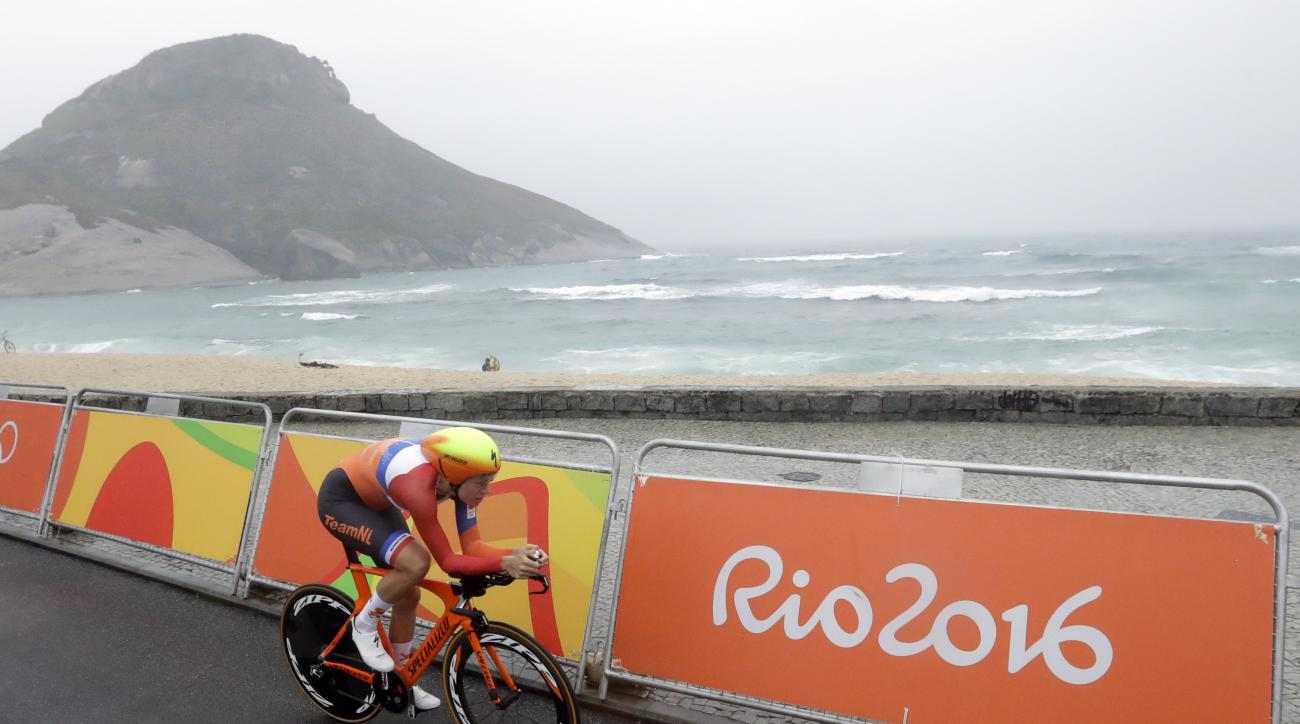 Cyclist Ellen van Dijk of Netherlands rides along Pontal beach during the women's individual time trial event at the 2016 Summer Olympics in Rio de Janeiro, Brazil, Wednesday, Aug. 10, 2016. (AP Photo/Victor R. Caivano)