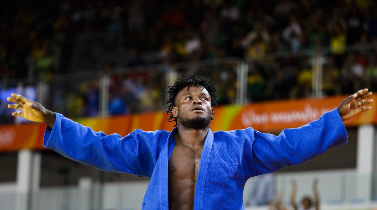 Popole Misenga, who competes for the Refugee Olympic Team, reacts after winning his first match against India's Avtar Singh during the men's 90-kg judo competition at the 2016 Summer Olympics in Rio de Janeiro, Brazil, Wednesday, Aug. 10, 2016. (AP Photo/