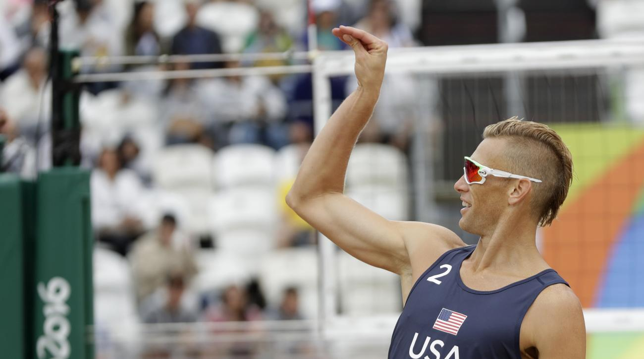 United States' Casey Patterson celebrates winning a point during a men's beach volleyball match against Spain at the 2016 Summer Olympics in Rio de Janeiro, Brazil, Wednesday, Aug. 10, 2016. (AP Photo/Petr David Josek)
