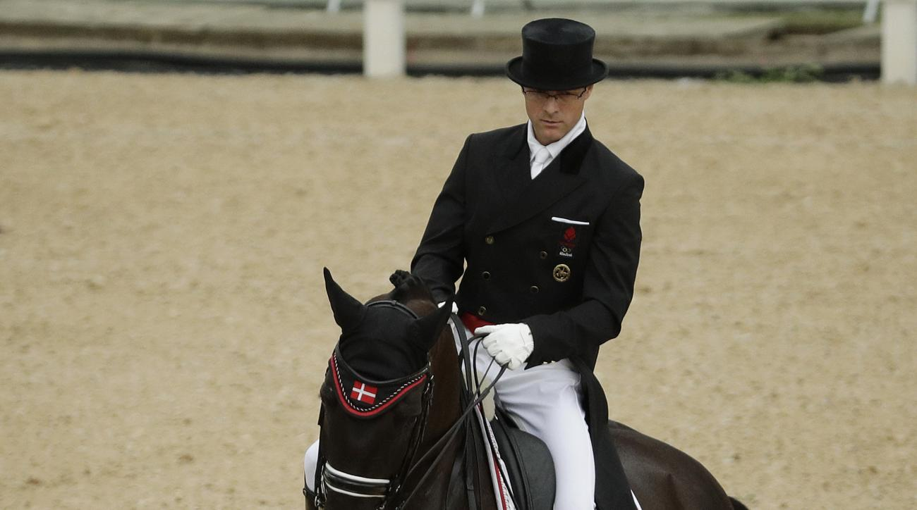Denmark's Anders Dahl, riding Selten HW, competes in the equestrian dressage competition at the 2016 Summer Olympics in Rio de Janeiro, Brazil, Wednesday, Aug. 10, 2016. (AP Photo/John Locher)