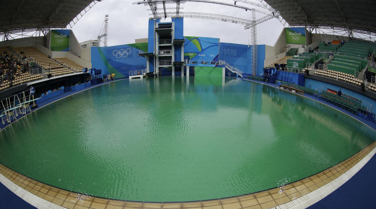 In this picture taken with a fish-eye lens, the water of the diving pool appears a murky green in the Maria Lenk Aquatic Center at the 2016 Summer Olympics in Rio de Janeiro, Brazil, Wednesday, Aug. 10, 2016. (AP Photo/Matt Dunham)