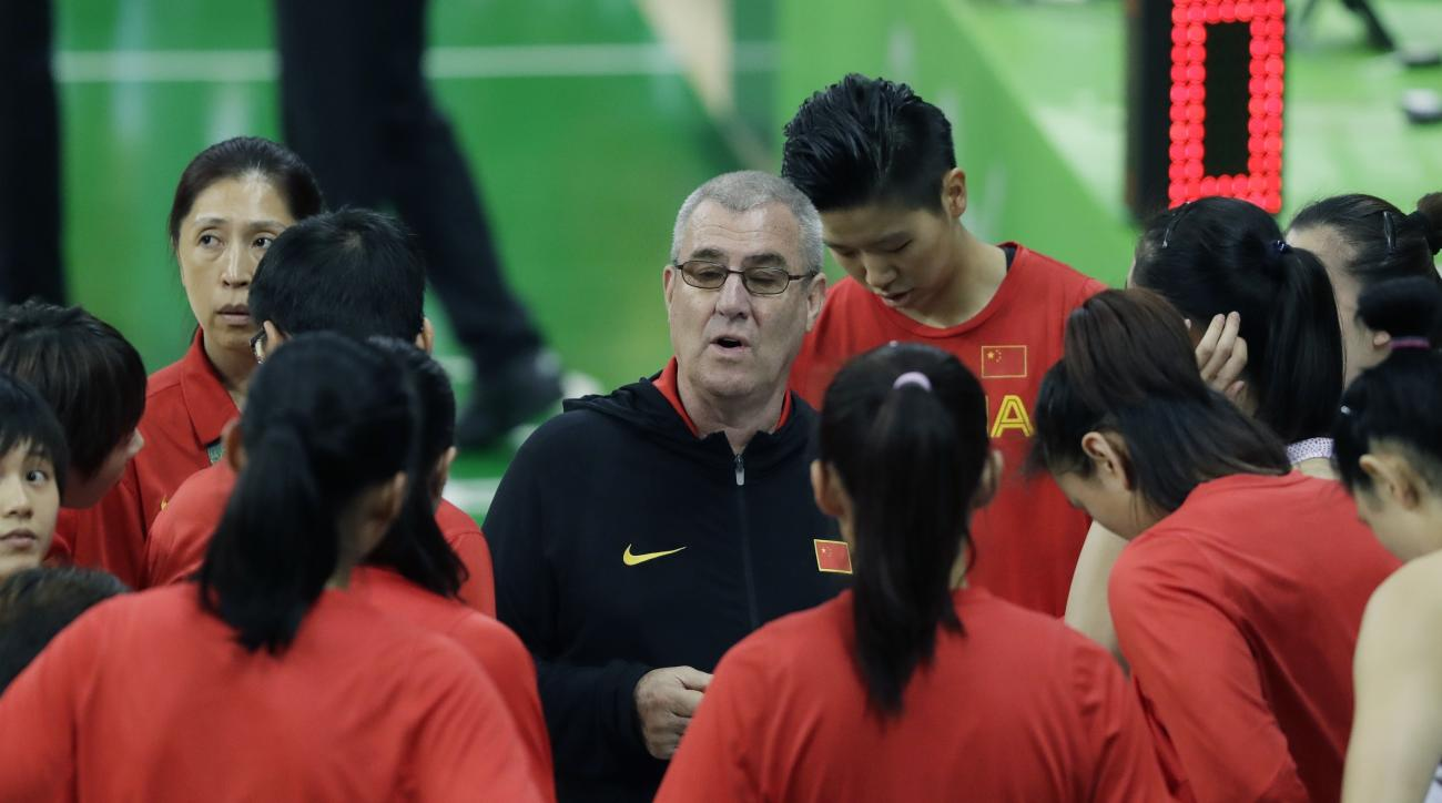 China head coach Tom Maher talks to his team during the first half of a women's basketball game against Spain at the Youth Center at the 2016 Summer Olympics in Rio de Janeiro, Brazil, Wednesday, Aug. 10, 2016. (AP Photo/Carlos Osorio)