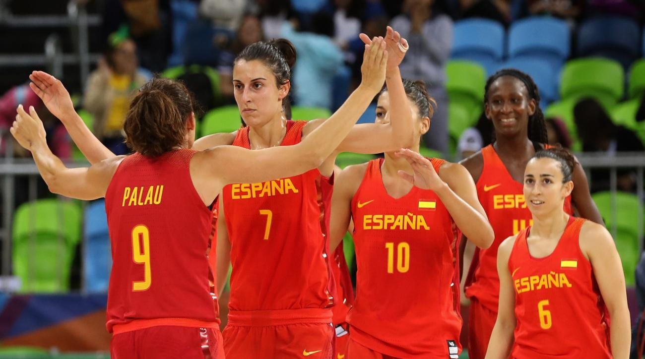 RIO DE JANEIRO, BRAZIL - AUGUST 10:  Alba Torrens #7 of Spain and Laia Palau #9 celebrate following their 89-68 win over China in the Women's Basketball Preliminary Round Group B match between China and Spain on Day 5 of the Rio 2016 Olympic Games at Yout