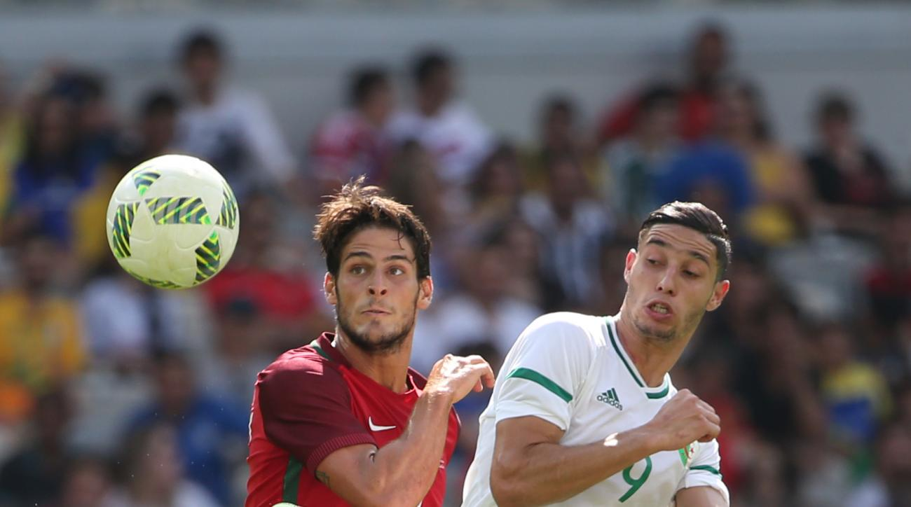 Portugal's Paciencia, left, fights for the ball with Algeria's Mohammed Benkablia during a group D match of the men's Olympic football tournament between Argelia and Portugal at the Mineirao Stadium in Belo Horizonte, Brazil, Wednesday, Aug. 10, 2016. (AP