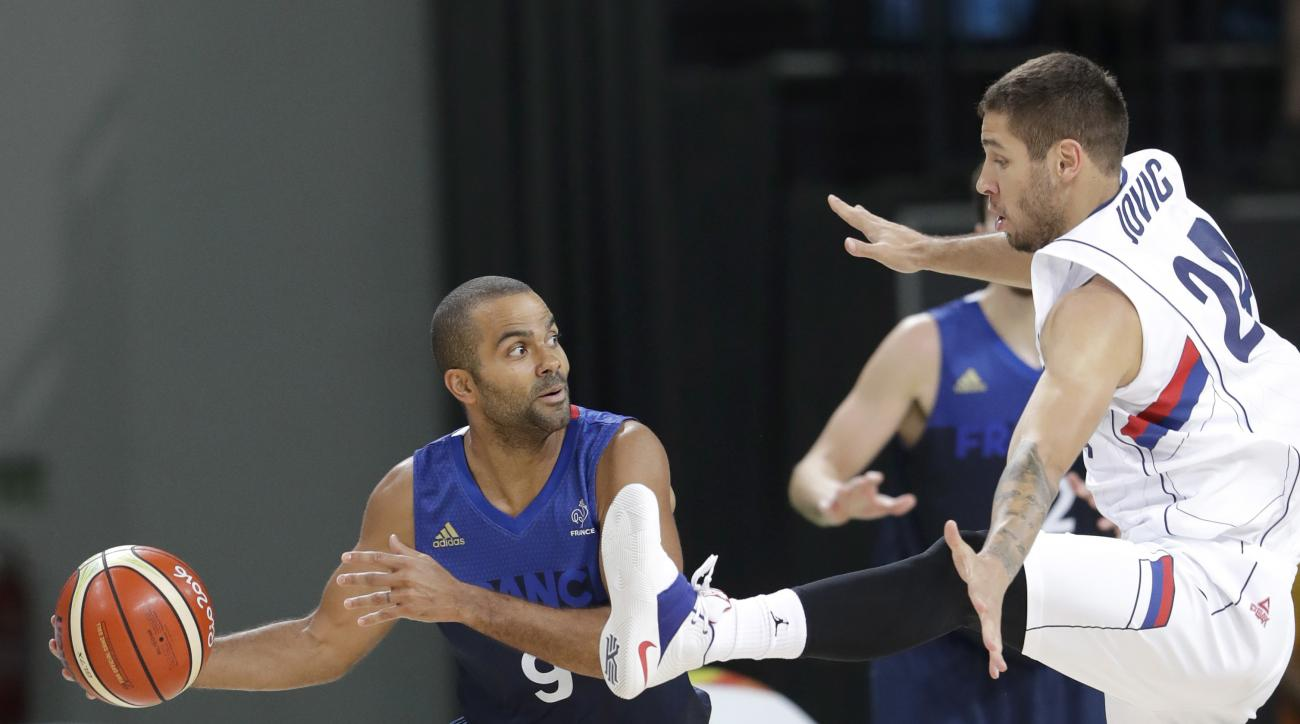 France's Tony Parker (9) is defended by Serbia's Stefan Jovic (24) during a men's basketball game at the 2016 Summer Olympics in Rio de Janeiro, Brazil, Wednesday, Aug. 10, 2016. (AP Photo/Eric Gay)