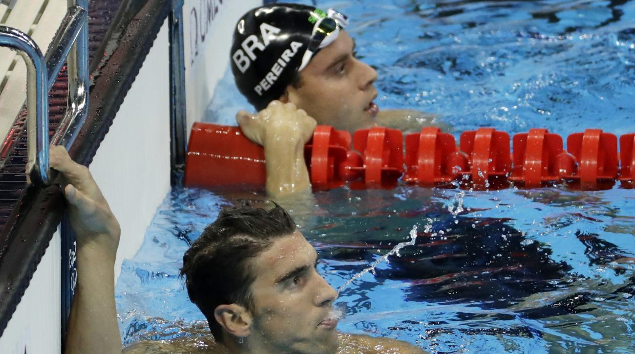 United States' Michael Phelps, left, wins a heat of the men's 200-meter individual medley ahead of second placed Brazil's Thiago Pereira during the swimming competitions at the 2016 Summer Olympics, Wednesday, Aug. 10, 2016, in Rio de Janeiro, Brazil. (AP