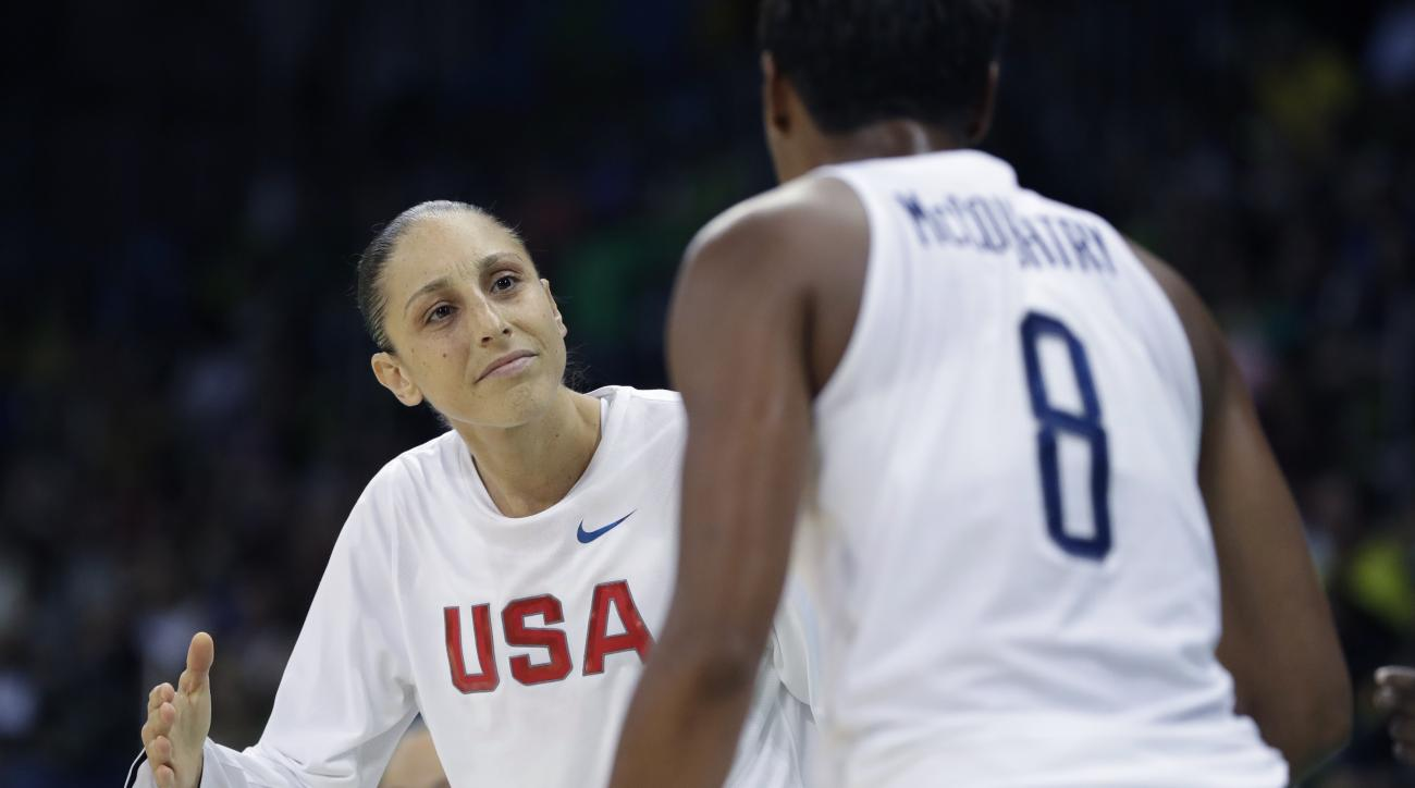 United States guard Diana Taurasi greets teammate Angel McCoughtry after a play during the second half of a women's basketball game against Senegal at the Youth Center at the 2016 Summer Olympics in Rio de Janeiro, Brazil, Sunday, Aug. 7, 2016. The United