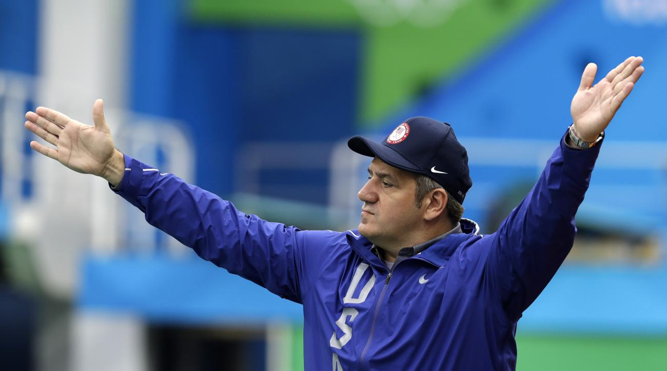 United States' coach Dejan Udovicic reacts as he watches his team play against France during their men's water polo preliminary round match at the 2016 Summer Olympics in Rio de Janeiro, Brazil, Wednesday, Aug. 10, 2016. (AP Photo/Eduardo Verdugo)