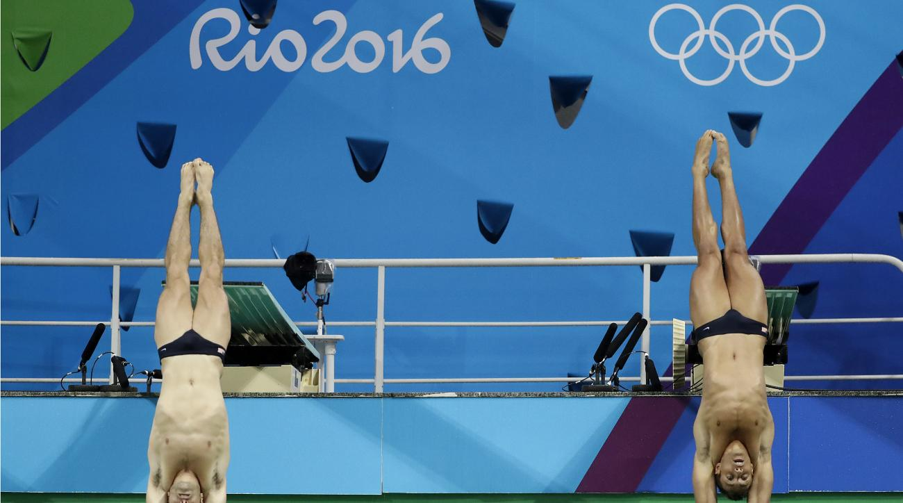 United States' Sam Dorman and Mike Hixon compete during the men's synchronized 3-meter springboard diving final in the Maria Lenk Aquatic Center at the 2016 Summer Olympics in Rio de Janeiro, Brazil, Wednesday, Aug. 10, 2016. (AP Photo/Wong Maye-E)