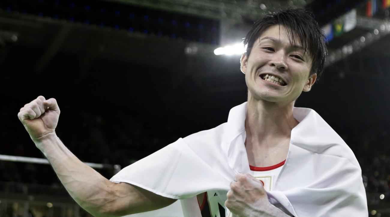 Japan's Kohei Uchimura celebrates his gold during the artistic gymnastics men's individual all-around final at the 2016 Summer Olympics in Rio de Janeiro, Brazil, Wednesday, Aug. 10, 2016. (AP Photo/Rebecca Blackwell)