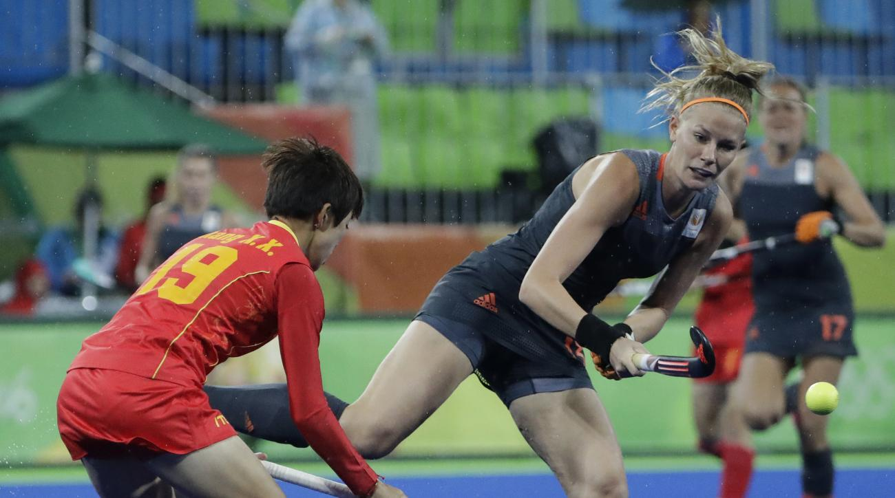 Netherlands' Caia Maasakker, right, fight for the ball against China's Xiaoxue Zhang, left, during a women's field hockey match at 2016 Summer Olympics in Rio de Janeiro, Brazil, Wednesday, Aug. 10, 2016. (AP Photo/Hussein Malla)
