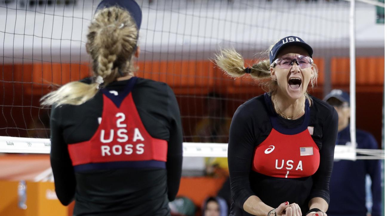 United States' April Ross, left, and Kerri Walsh Jennings celebrate a point against Switzerland during a women's beach volleyball match at the 2016 Summer Olympics in Rio de Janeiro, Brazil, Wednesday, Aug. 10, 2016. (AP Photo/Marcio Jose Sanchez)
