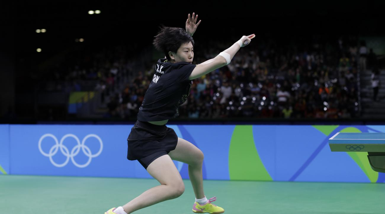 Li Xiaoxia of China plays against Ding Ning of China during their women singles table tennis final match at the 2016 Summer Olympics in Rio de Janeiro, Brazil, Wednesday, Aug. 10, 2016. (AP Photo/Petros Giannakouris)