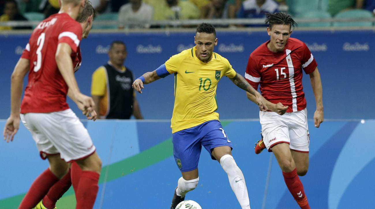 Brazil's Neymar controls the ball past Denmark's Pascal Gregor during a group A match of the men' s Olympic football tournament between Brazil and Denmark in Salvador, Brazil, Wednesday Aug. 10, 2016. Brazil won the match 4-0.(AP Photo/Leo Correa)