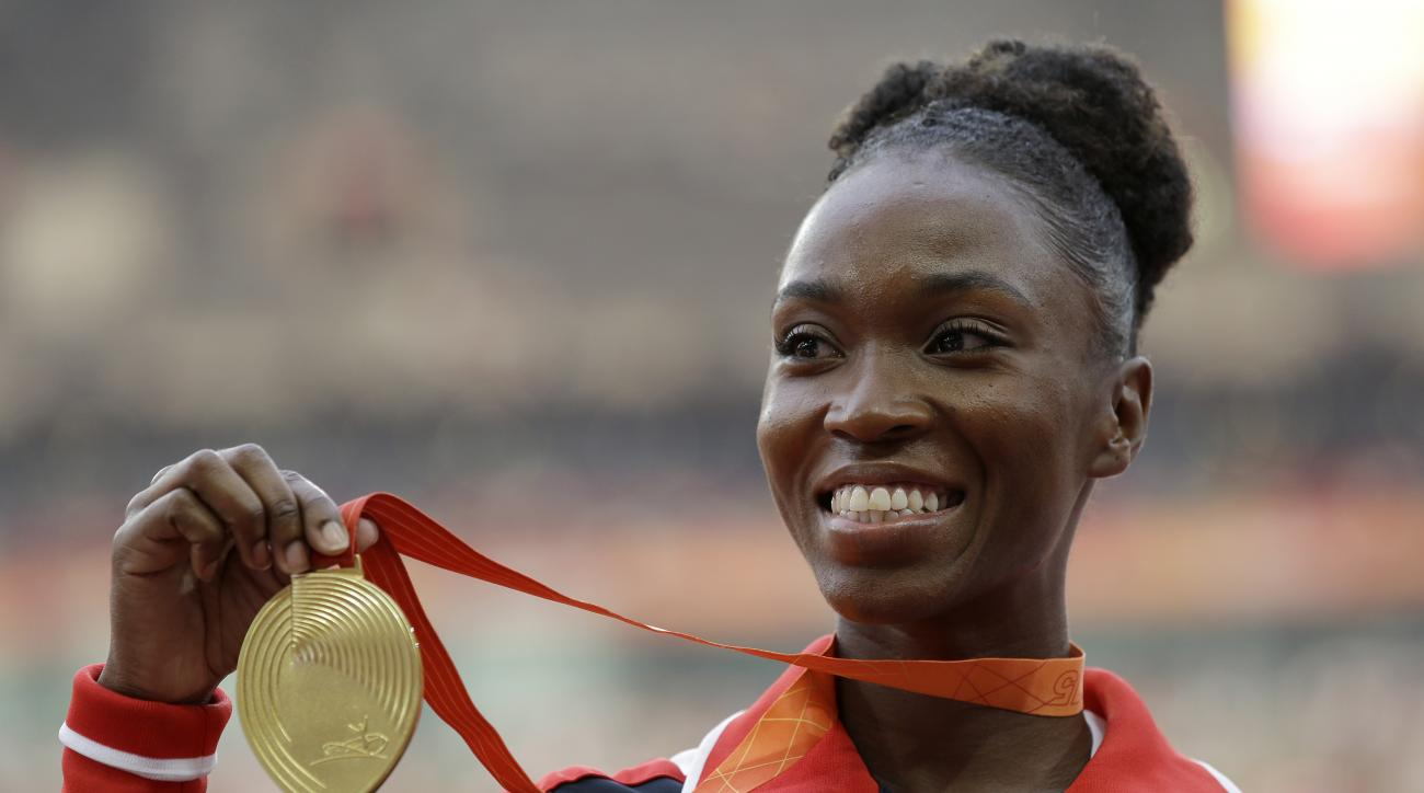 FILE - In this Aug. 29, 2015, women's long jump gold medalist United States' Tianna Bartoletta celebrates on the podium at the World Athletics Championships at the Bird's Nest stadium in Beijing. Bartoletta is going for gold at the 2016 Summer Olympics in