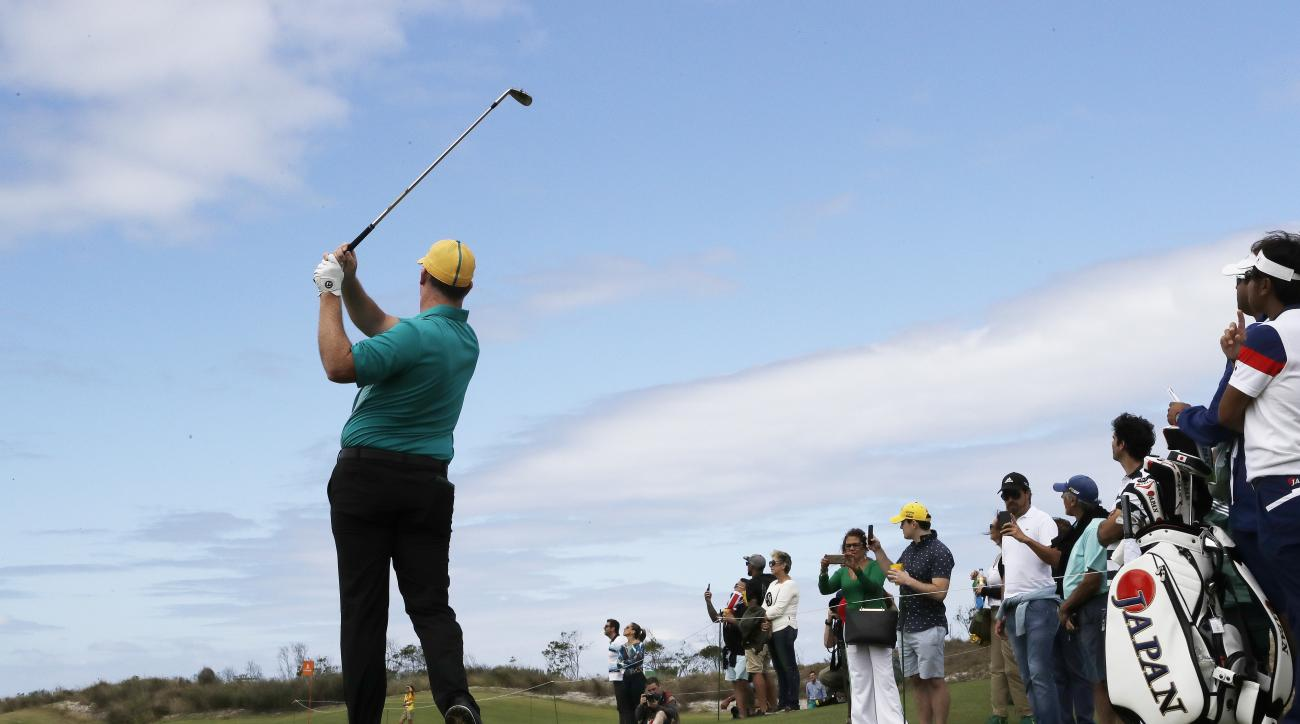 Marcus Fraser of Australia watches his tee shot on the 17th tee during the first round of the men's golf event at the 2016 Summer Olympics in Rio de Janeiro, Brazil, Thursday, Aug. 11, 2016. (AP Photo/Chris Carlson)
