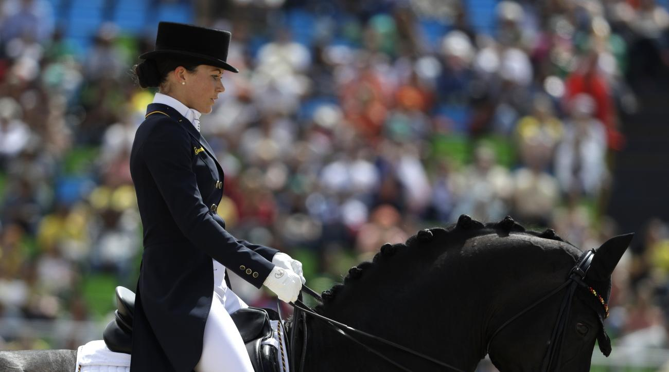Germany's Kristina Broring-Sprehe, riding Desperados FRH, competes in the equestrian dressage competition at the 2016 Summer Olympics in Rio de Janeiro, Brazil, Thursday, Aug. 11, 2016. (AP Photo/John Locher)