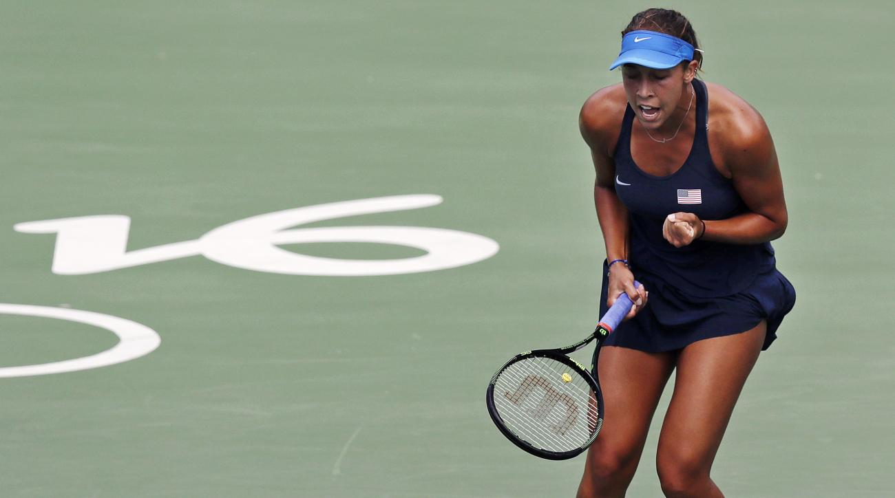 Madison Keys, of the United States, pumps her fist after winning the first set against Daria Kasatkina, of Russia, at the 2016 Summer Olympics in Rio de Janeiro, Brazil, Thursday, Aug. 11, 2016. (AP Photo/Charles Krupa)