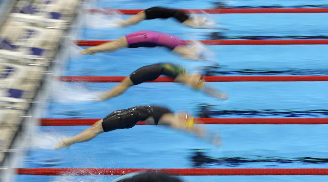 Athletes start a women's 100-meter backstroke heat during the swimming competitions at the 2016 Summer Olympics, Thursday, Aug. 11, 2016, in Rio de Janeiro, Brazil. (AP Photo/Matt Slocum)