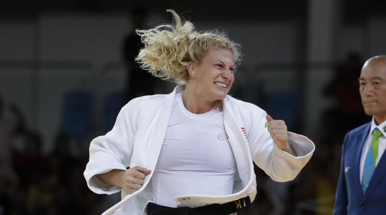 United States' Kayla Harrison celebrates after winning the gold medal of the women's 78-kg judo competition at the 2016 Summer Olympics in Rio de Janeiro, Brazil, Thursday, Aug. 11, 2016. (AP Photo/Markus Schreiber)