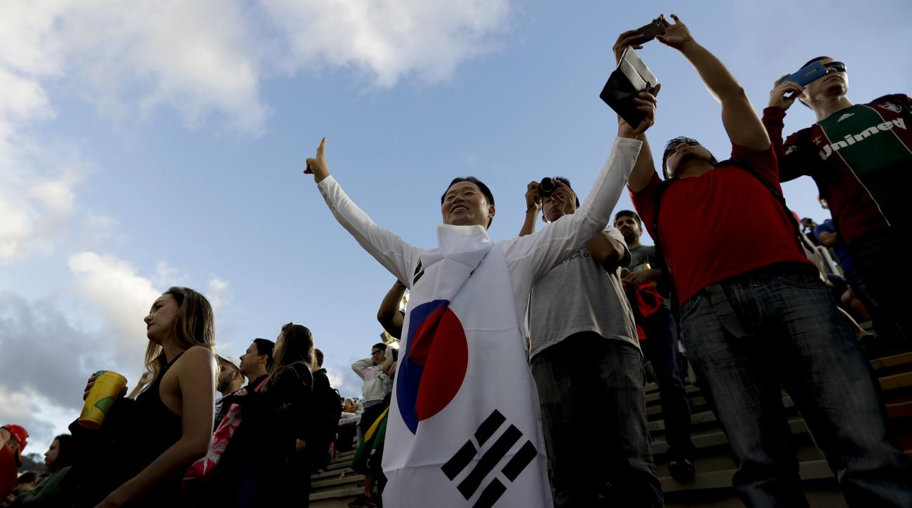 A fan from South Korea watches the awards ceremony of the individual archery women competition at the Sambadrome venue during the 2016 Summer Olympics in Rio de Janeiro, Brazil, Thursday, Aug. 11, 2016. (AP Photo/Natacha Pisarenko)