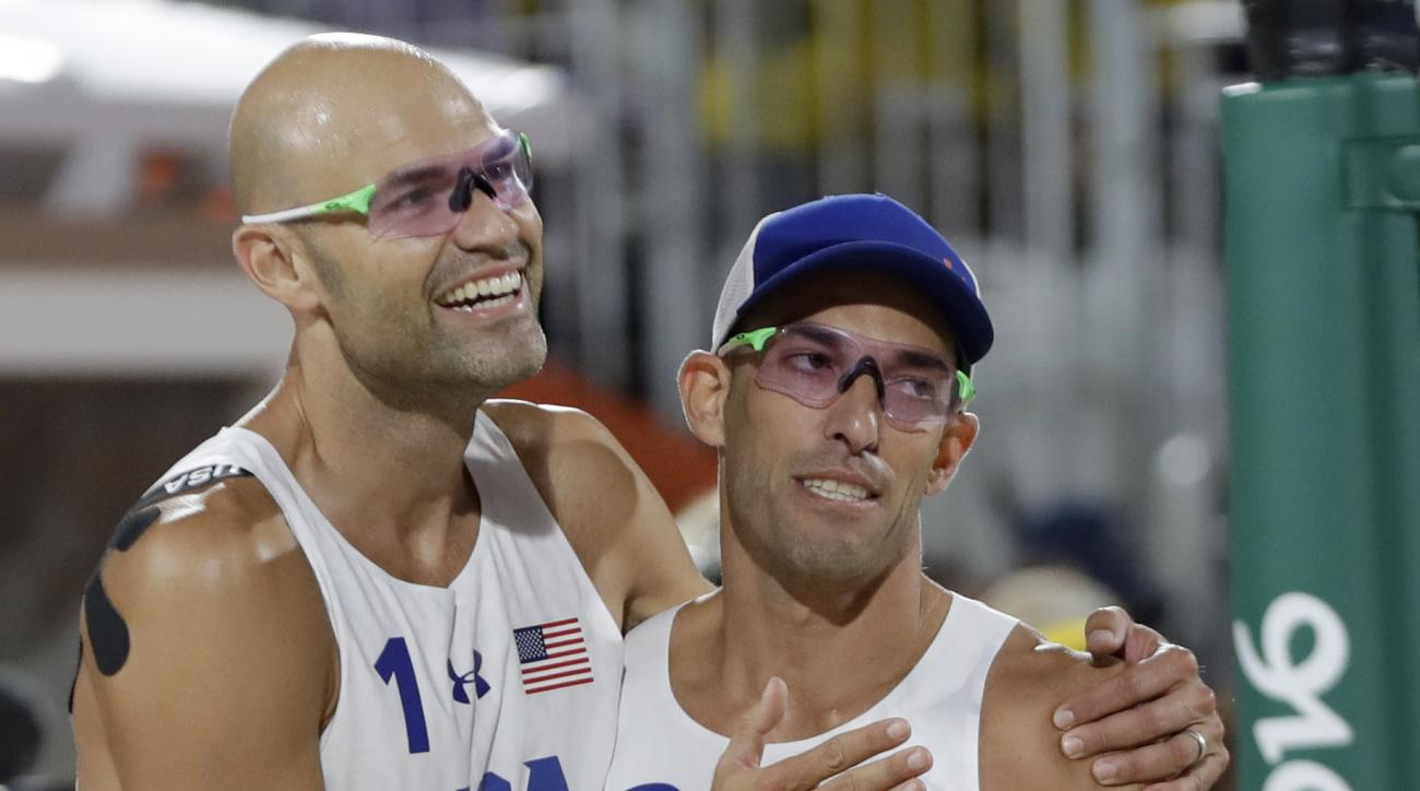 United States' Phil Dalhausser, left, and Nicholas Lucena, right, celebrates after defeating Italy during a men's beach volleyball match at the 2016 Summer Olympics in Rio de Janeiro, Brazil, Thursday, Aug. 11, 2016. (AP Photo/Petr David Josek)